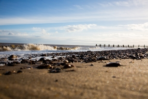 Photograph of pebbles on the sand at Corton beach, Lowestoft Suffolk